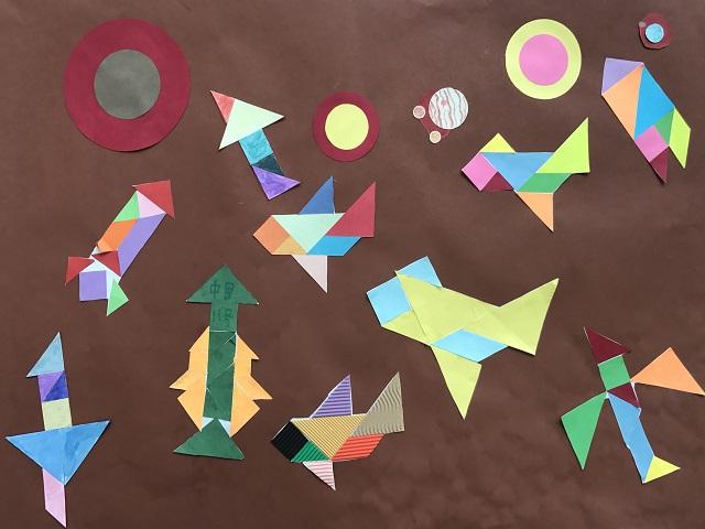同学们利用所学的知识,不同的材料,手里的画笔和剪刀,将图形的轴对称